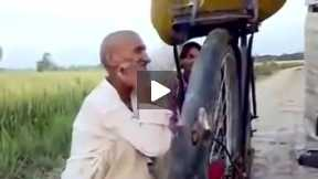 Old man singing a song during bicycle running