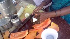 Making a Papaya fruit salad.